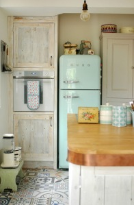 Beautiful vintage kitchen with retro blue fridge