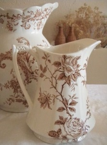Vintage porcelain pitchers with flowers